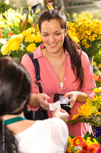 Woman customer taking receipt flower shop buying