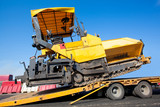 Transportation tracked paver machine during roadworks