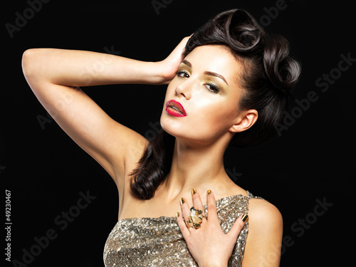 Beautiful woman with golden nails and fashion makeup