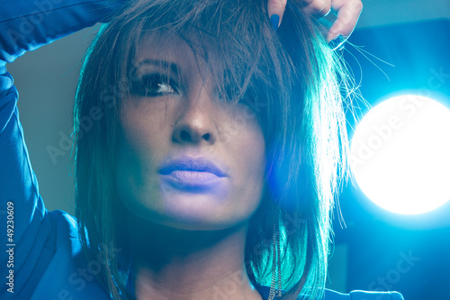 Pretty woman with blue backlight