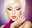 Beautiful woman with bright violet purple makeup