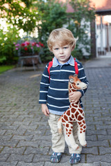 Adorable preschooler on way to school kindergarten summer