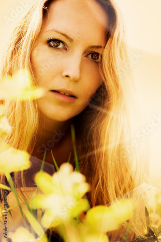 Beautiful blonde woman on grass