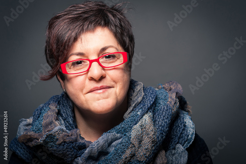 Middle age woman with red glasses close up portrait