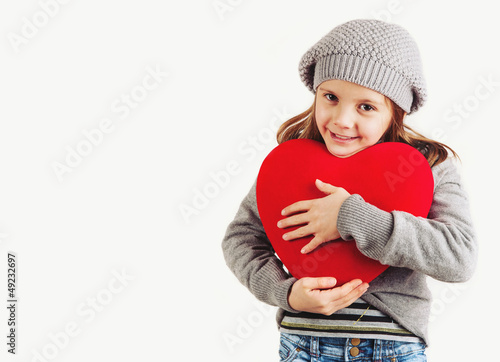 Young girl with red heart on white background.