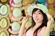 beautiful asian woman with hat shop