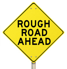 Yellow Warning Sign - Rough Road Ahead - Isolated