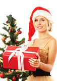 Beautiful girl in santa hat with gift