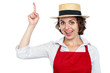 Excited chef woman pointing upwards