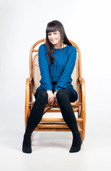 young woman in chair is smiling