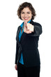 Joyous corporate woman pointing you out