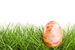 Colorful easter egg in the grass - isolated over white