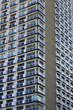 Tall apartment building with balconies and windows