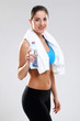 Young woman in fitness wear with towel