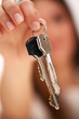Beautiful woman holds keys