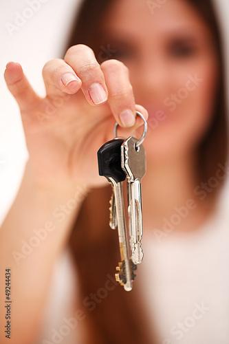 Beautiful woman holds keys