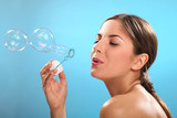 Natural caucasian woman with bubble blower