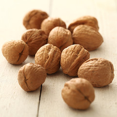 Handful of walnuts on a table