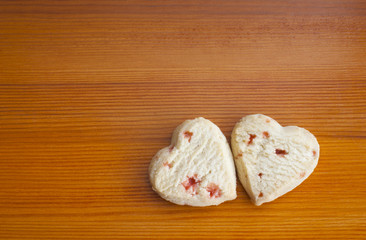 Love hearts strawberry shortcakes on a wooden table