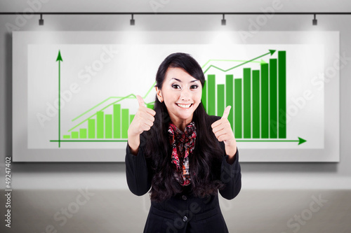 Successful business woman with bar chart