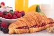 breakfast with croissant and fruits