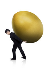 Businessman carry huge gold egg