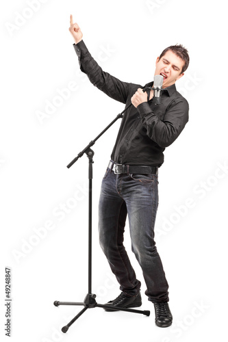 Full length portrait of a male singer performing a song