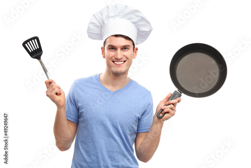 Chef holding cooking utensils