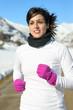 Beautiful runner on winter snow mountain
