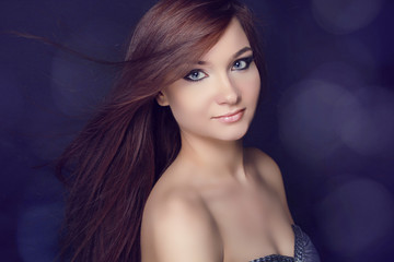 Young beautiful woman with long brown magnificent hair.  Closeup