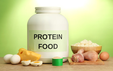 jar of protein powder and food with protein, on green