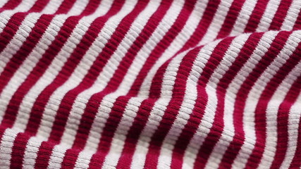 Red and white striped cloth background, sliding video