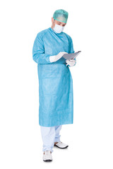 Doctor In Operation Gown Writing On Folder