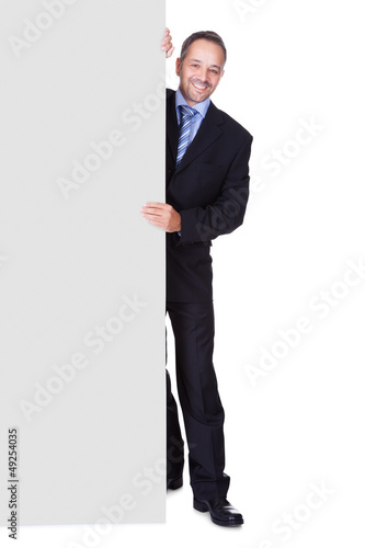 Happy Businessman Holding Blank Billboard
