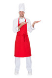Portrait of cheerful chef in uniform presenting