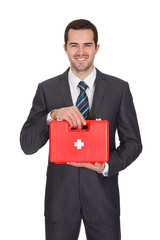 Happy Businessman Holding First Aid Box