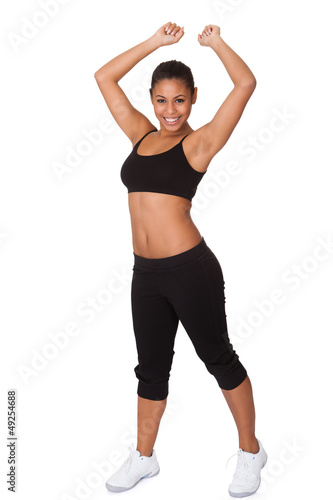 Portrait Of Excited Young Woman Jumping