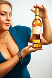 Sexy young woman with bottle of rum