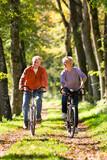 Fototapety Seniors exercising with bicycle