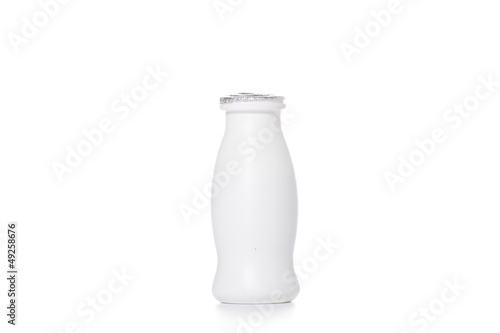 Bottle of milk on a white background