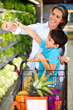 Woman grocery shopping with her kid