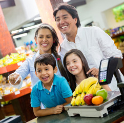 Family paying at the supermarket