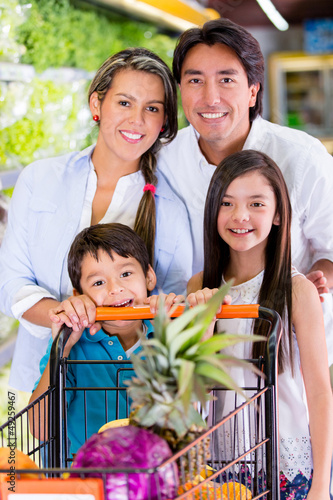 Happy family at the supermarket