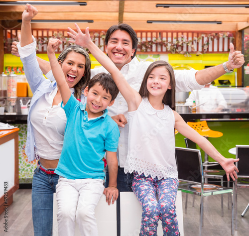 Excited family at a cafeteria