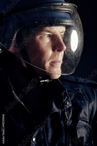 Riot Policeman with a Helmet