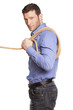 Young man holding a rope on white background