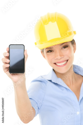 Engineer or architect woman showing smart phone