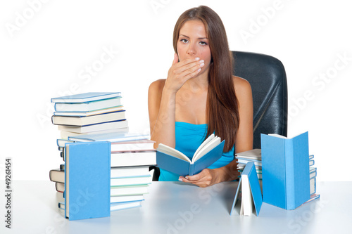 tired teen girl with books