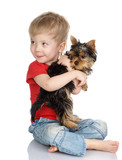 Stock Photo: child and yorkshire terrier. isolated on white
