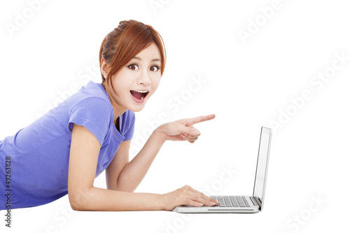 surprised young woman with laptop